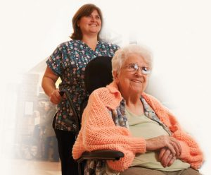 Nurse helping elderly woman in wheelchair.